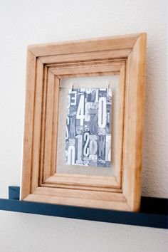 a cool way to use frames that are missing the glass: use a piece of wire and tiny clothespins or clips