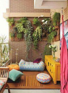 outdoor oasis, outdoor rugs, outdoor living, hanging plants, garden art