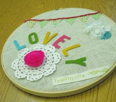 Embroidery Hoop Art. Lace doily, felt letters. Adorable.