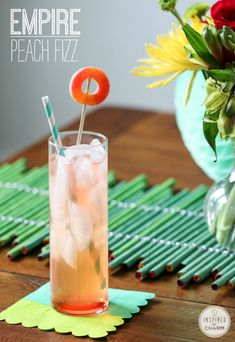 A perfectly peach-inspired cocktail! Complete with a gummy peach ring! Empire Peach Fizz