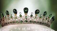 "The ""Queen Victoria's Emerald and Diamond Tiara"" was one of the most exquisitely crafted tiaras in her collection, and also one of her favorite pieces of jewelry, designed by her own husband, the Prince Consort, Prince Albert of Saxe-Coburg and Gotha, in the Gothic style. mdwhite"