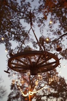 Rustic wagon wheel chandelier. Wedding by Jordan Payne Events. Photo by Sarah Kate, Photographer. #wedding #chandelier #rustic #country
