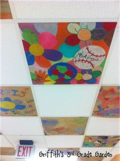 Students are given a brown paper square to decorate on family art night.  The PTA then attaches it to the ceiling tiles in the hall.
