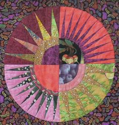 """close up,  """"4 square in N.Y. Beauty"""" by Nancy Bourns.  2013 DVQG, photo by Quilt Inspiration.  Interesting prints including blueberries."""