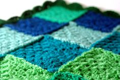As A Bugg – Crochet baby blanket, granny squares with shell stitch border.