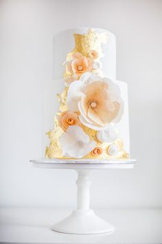 Gold accented wedding cake with peach flowers from Sweet Bakes in AU. Great inspiration.