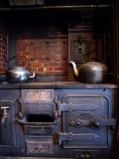 coal range - oven on the right and a hot water tank with tap on the left, 1903