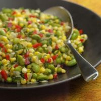 Herbed Corn & Edamame Succotash  From: EatingWell  Fresh green soybeans, called edamame or sweet beans, are a great addition to this classic American dish, where they stand in for the traditional lima beans. The succotash is wonderful as it is or topped with grilled shrimp, salmon or chicken.