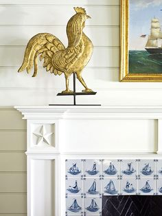 We love this vintage golden rooster and blue-and-white nautical tiles - Traditional Home®