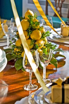 42 Simple Holiday Decorating Tips - Traditional Home® dining rooms, table settings, chandeliers, centerpieces, holiday decorating, christmas trees, traditional homes, decorating tips, lemon