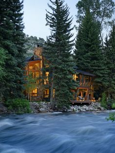 """""""In this house you can see and hear the river from every room,"""" the homeowner says. It is a beautiful display of architecture and landscape designed by David Johnston Architects."""