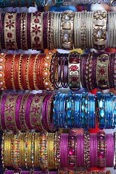 """Inspiration of India, like the Electric Sheen eye-shadows. These are handmade #Bangles sold on the street markets in India. Aren't they gorgeous?"""