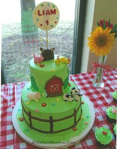 Farmyard first birthday cake with a super cute haystack smash cake and farm animal cupcake toppers.