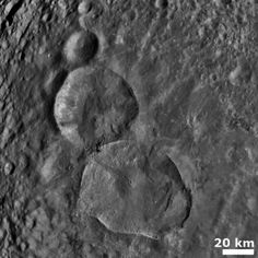 """""""Snowman"""" on the asteroid Vesta. (2011-08-06) Three craters imaged by NASA's Dawn mission."""