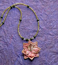 Origami flower necklace. Thus little jewel looks hard to make but it is really easy to fold and is so lightweight.