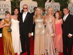 is: Daughter Francesca, Clint's wife Dina, Clint, daughter Kathryn ...