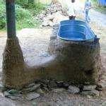 rocket stove... wood heated tub