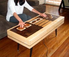 Fully-Functional Nintendo Controller Coffee Table. Not in my house. Not ever! LOL!