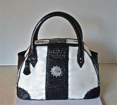 White pearl fondant purse cake with black fondant trim and edible silver detail