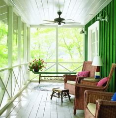 I like the green painted wall, white floor and ceilings on this screened in porch