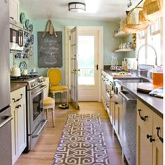 Love this kitchen! Lots of stuff...tastefully done!