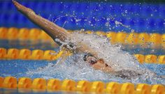 Missy Franklin of the U.S. swims to win gold in the women's 200m backstroke final with a world record.