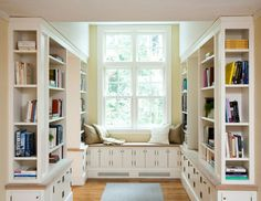 A lovely window lounger offers sunny seating for a crafted library nook.