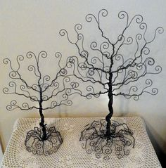 wire tree stands, jewelry organizers.  I have a very similar one, which I bought in Zimbabwe and I love it; it is practical for rings, bracelets and earrings and looks great too on my dresser.