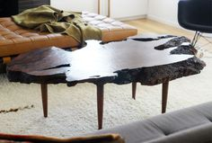 """Wooden Coffee Table 'Leggy':   """"I picked up this hunky bit of burl some time ago with plans to rip off those too tall and weirdly sad peg legs that had been slapped on it. This chunk of redwood burl is everything I've been dreaming of in a coffee table, so I wanted to do something spectacularly special and possibly brassy for the base..."""""""