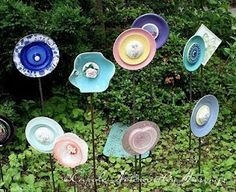 Recycled plates and bowls into flowers garden ornaments.  We got one of these last year at a craft show but it would be fun to have a few together! I love how colorful these are!