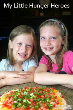 My granddaughters with one of the dishes they created for their cookbook. Taco Dip is simple and SO delicious!