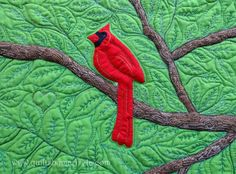 (Detail)  This spring I got a stalker.  He watched me almost every time I left or came home. One day I was lucky and I was able to shoot a great pic of him through my window. He's gone now and I miss him. Here is the quilt I made out of his picture.   By the way, my students in next Saturday's Free Motion Quilting class are going to be the first ones to see this quilt in person and learn how to quilt leaves plus many other motifs.    QUILTS BY MARISELA original design.