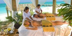 Enjoy a couples massage on the beach with the one you love at Sandals Resorts, Red Lane Spa