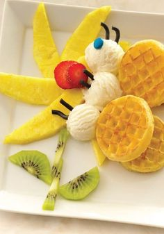 Create this Butterfly on a Flower with fruit, ice cream, waffles and candy! Super easy to make.