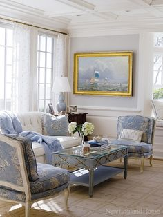 A formal living room in a Cape Cod home done in understated shades of blue. Photo by Miki Duisterhof.