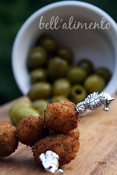 Fried olives with cheese and herbs. Fried olives? How can you go wrong with fried olives?