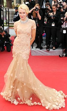 Naomi Watts in a feather-embellished Marchesa gown topped off with Chopard jeweley. Cannes 2012.