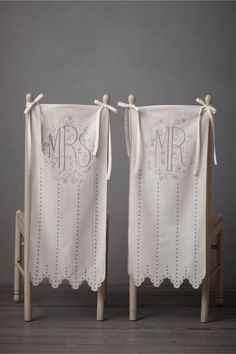 Eyelet Chair Banners  from BHLDN  I like the idea of it - but wish there was a 'Ms' and 'Mr' option - or do you think that's missing the point?