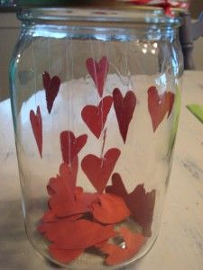 Paper hearts and Mason jar Valentine's Day table decorations