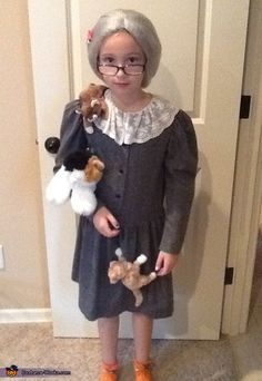 Jennifer: I bought the dress from goodwill and then sewed on the little cats. Pretty easy. Emily won grand prize with this costume.