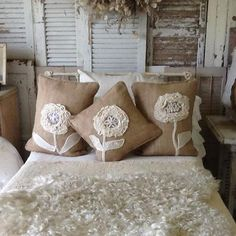 Burlap pillows with old lace flowers