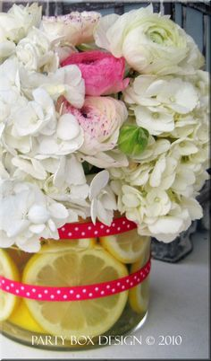 For a fun pop of color, fill the bottom of a centerpiece with lemons (or limes!) #partydecor