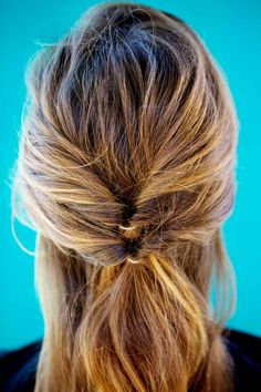 Grab a two-inch section below the original ponytail, and repeat the whole process, flipping hair through. The tails should be stacked, one directly above the other. You can stop here or, if you have thick or long hair, add one more flipped ponytail below.