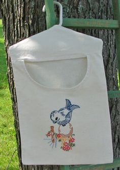 I would love to make a clothespin bag with pretty embroidery!