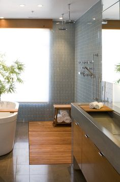 contemporary bathroom by modern house architects, teak flooring in the shower
