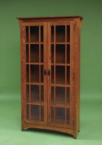 This Arts & Crafts style bookcase is Amish handcrafted from solid hardwood.    Enhance your home decor with our classic Mission Double Door Bookcase which is constructed of 100% solid hardwood. This gorgeous solid wood craftsman double door bookcase is built in the style of the Arts & Crafts movement.     $1008