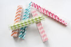 old time paper straws that would make WIlly Wonka proud....http://kandeelandkandeeland.blogspot.com/2012/01/cupcakes-1st-birthday-party.html