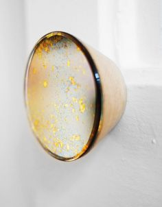 Antique mirror wall hooks - via Coco Lapine Design
