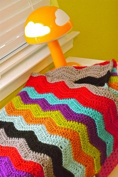 A crocheted blanket could be a fun project to get me back into crocheting this autumn and winter. The colors would definitely keep me interested.