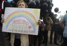 """And this one says, """"Love is stronger than hate."""" 
